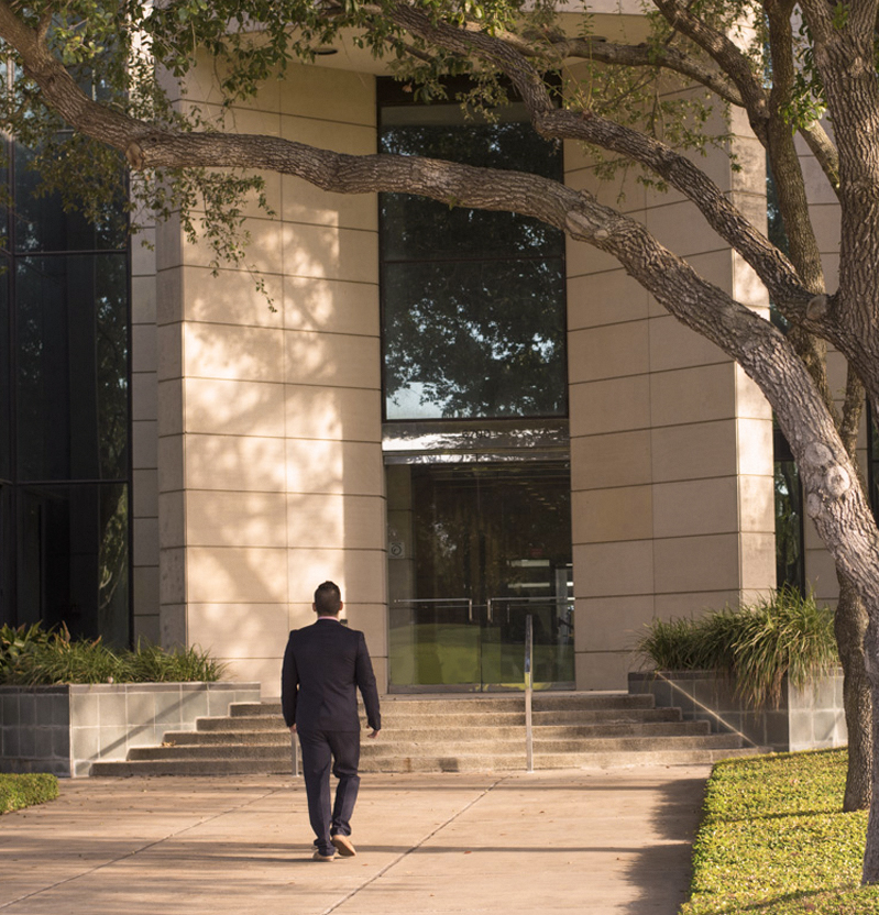 A man walking into a building's entrance.